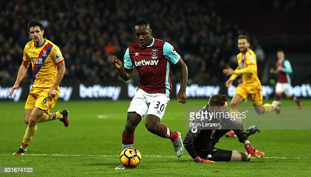 Michail Antonio of West Ham United takes the ball past Wayne Hennessey of Crystal Palace during the Premier League match between West Ham United and...