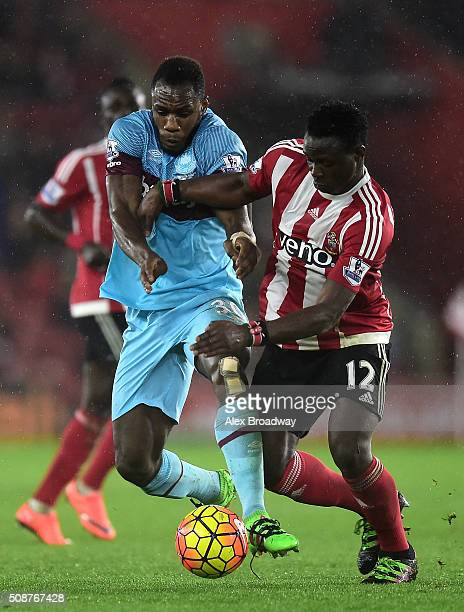 Michail Antonio of West Ham United tussles with Victor Wanyama of Southampton during the Barclays Premier League match between Southampton and West...