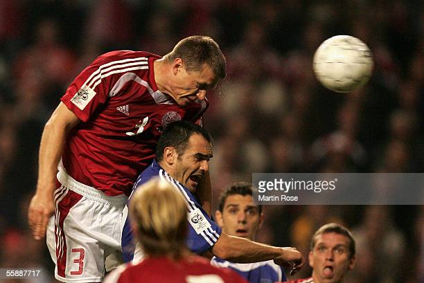 Michail Kapsis of Greece and Michael Gravgaard of Denmark heads the ball during the FIFA World Cup 2006 Group 2 Qualifier match between Denmark and...