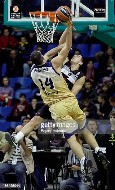 Michailis Anisimov #14 of Budivelnik Kiev competes with Dragan Milosavljevic #12 of Partizan NIS Belgrade in action during the 20132014 Turkish...