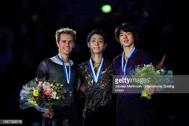 Michal Brezina of Czech Republic Yuzuru Hanyu of Japan and Junhwan Cha of Korea pose in the Men's medal ceremony during day three of the ISU Grand...