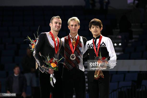 Michal Brezina of the Czech Republic Kevin Van Der Perren of Belgium and Takahiko Kozuka of Japan stand on the awards podium after the men's...