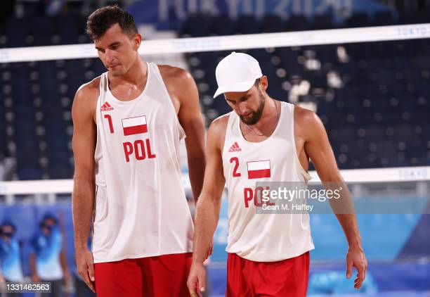 Michal Bryl and Grzegorz Fijalek of Team Poland react against Team Brazil during the Men's Preliminary - Pool E beach volleyball on day seven of the...