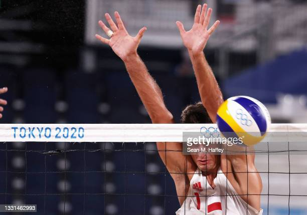 Michal Bryl of Team Poland competes against Team Brazil during the Men's Preliminary - Pool E beach volleyball on day seven of the Tokyo 2020 Olympic...