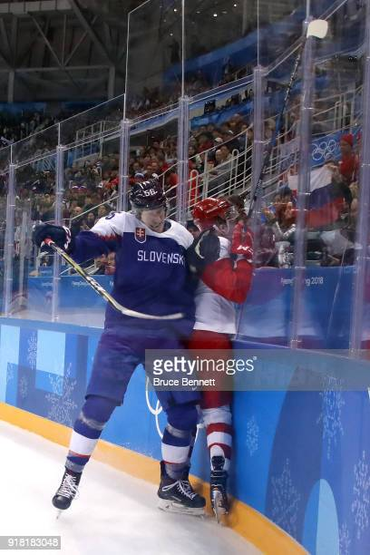 Michal Cajkovsky of Slovakia collides with Kirill Kaprizov of Olympic Athlete from Russia in the third period during the Men's Ice Hockey Preliminary...