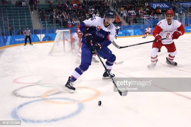 Michal Cajkovsky of Slovakia controls the puck against Artyom Zub of Olympic Athlete from Russia in the first period during the Men's Ice Hockey...