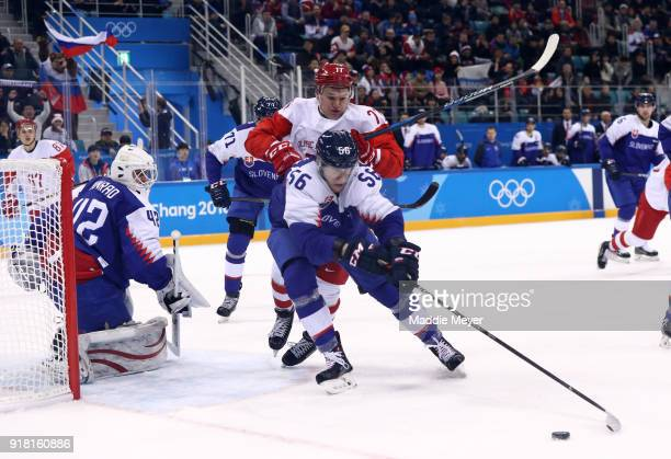 Michal Cajkovsky of Slovakia handles the puck against Kirill Kaprizov of Olympic Athlete from Russia in the first period during the Men's Ice Hockey...