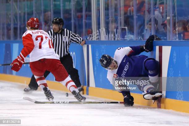 Michal Cajkovsky of Slovakia hits the boards against Kirill Kaprizov of Olympic Athlete from Russia in the first period during the Men's Ice Hockey...