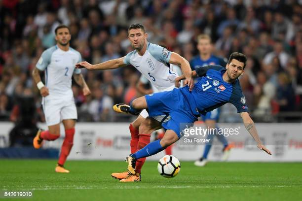 Michal Duris of Slovakia and Gary Cahill of England during the FIFA 2018 World Cup Qualifier between England and Slovakia at Wembley Stadium on...