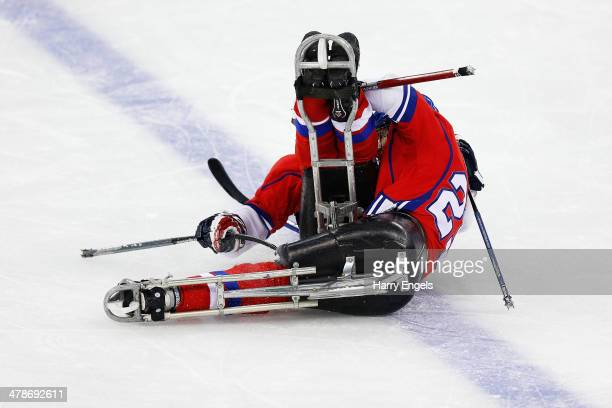 Michal Geier of Czech Republic celebrates with teammate Pavel Kubes after scoring his team's third goal during the Ice Sledge Hockey classifications...