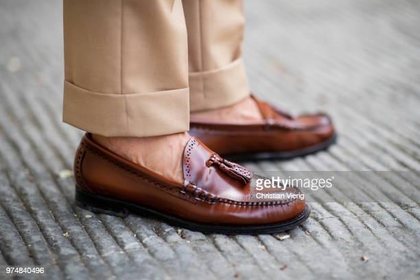 Michal Gronowski wearing Harrisons Mersolair linen bespoke safari jacket Sebastian Zukowski, tropic wool bespoke trousers with high waist and two...