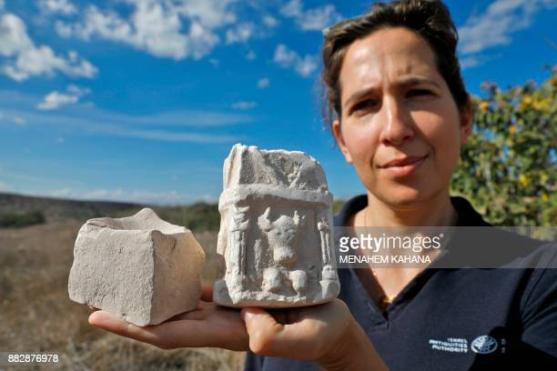 Michal Haber a member of the Israeli Antiquities Authority displays an Edomean era incense burner adorned with an image of a bull that was recently...