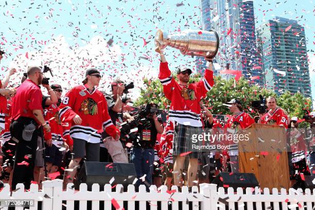 Michal Handzus forward for the Chicago Blackhawks raises the Stanley Cup Trophy during the Chicago Blackhawks' 2013 Stanley Cup Championship rally at...