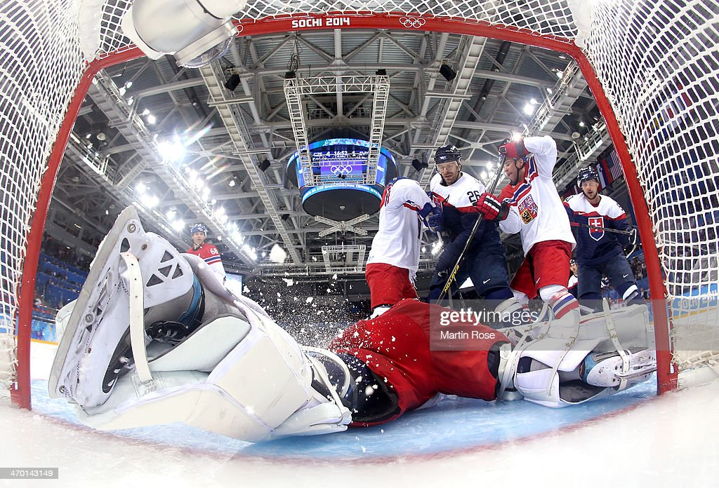 Michal Handzus #26 of Slovakia fights for position in front of Ondrej Pavelec #31 of Czech Republic in the third period during the Men's Qualification Playoff Game on day 11 of the Sochi 2014 Winter Olympics at Shayba Arena on February 18, 2014 in Sochi, Russia.