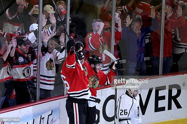 Michal Handzus of the Chicago Blackhawks celebrates with Patrick Kane after scoring a goal against Jonathan Quick of the Los Angeles Kings in double...