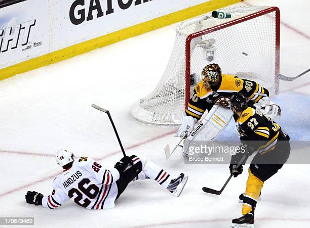 Michal Handzus of the Chicago Blackhawks falls to the ice after scoring a goal in the first period against Tuukka Rask of the Boston Bruins in Game...
