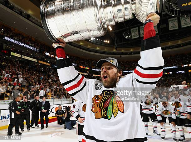 Michal Handzus of the Chicago Blackhawks hoists the Stanley Cup after his team defeated the Boston Bruins 32 in Game Six of the 2013 Stanley Cup...