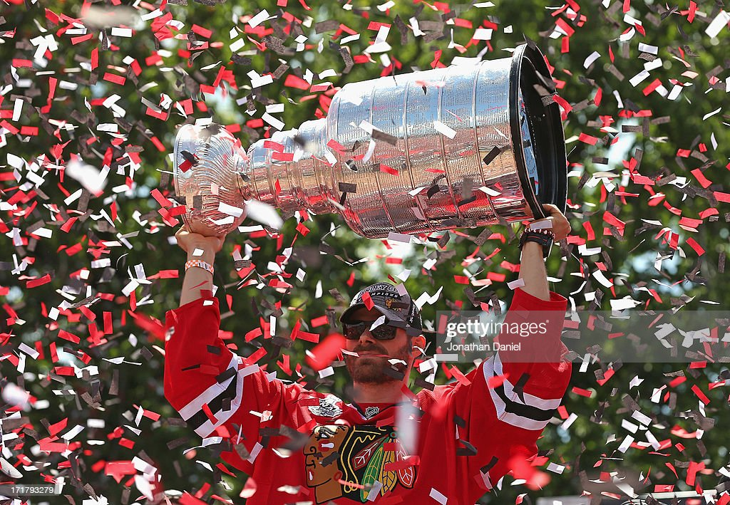 Michal Handzus #26 of the Chicago Blackhawks holds the Stanley Cup Trophy during the Blackhawks Victory Parade and Rally on June 28, 2013 in Chicago, Illinois.