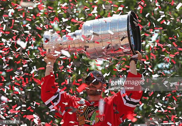 Michal Handzus of the Chicago Blackhawks holds the Stanley Cup Trophy during the Blackhawks Victory Parade and Rally on June 28 2013 in Chicago...