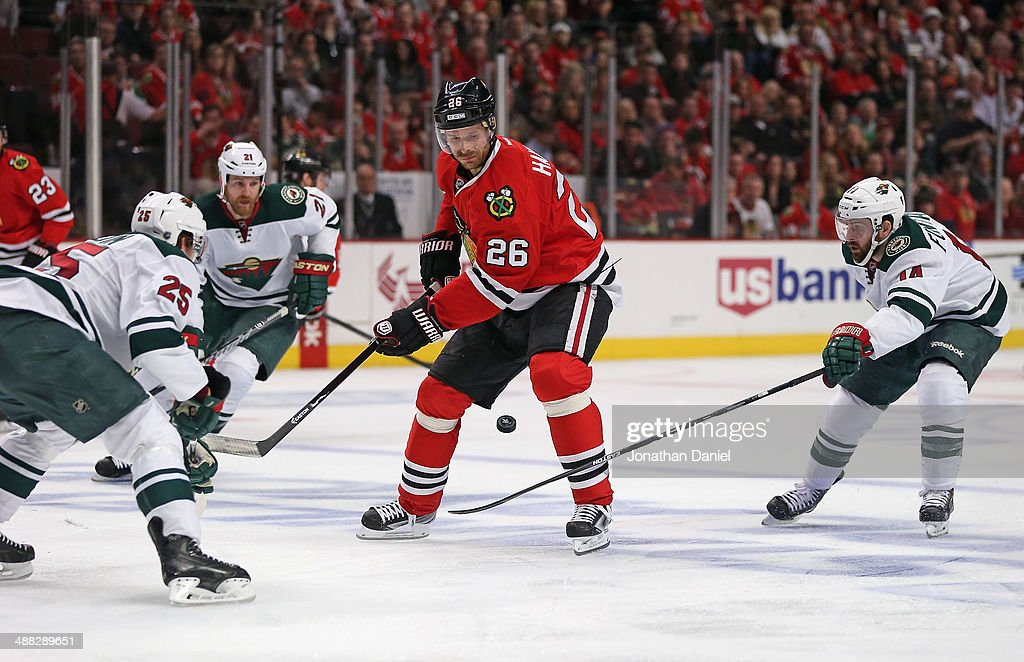Michal Handzus #26 of the Chicago Blackhawks is pressured by (L-R) Jonas Brodin #25, Kyle Brodziak #21 and Justin Fontaine #14 of the Minnesota Wild in Game Two of the Second Round of the 2014 NHL Stanley Cup Playoffs at the United Center on May 4, 2014 in Chicago, Illinois. The Blackhawks defeated the Wild 4-1.