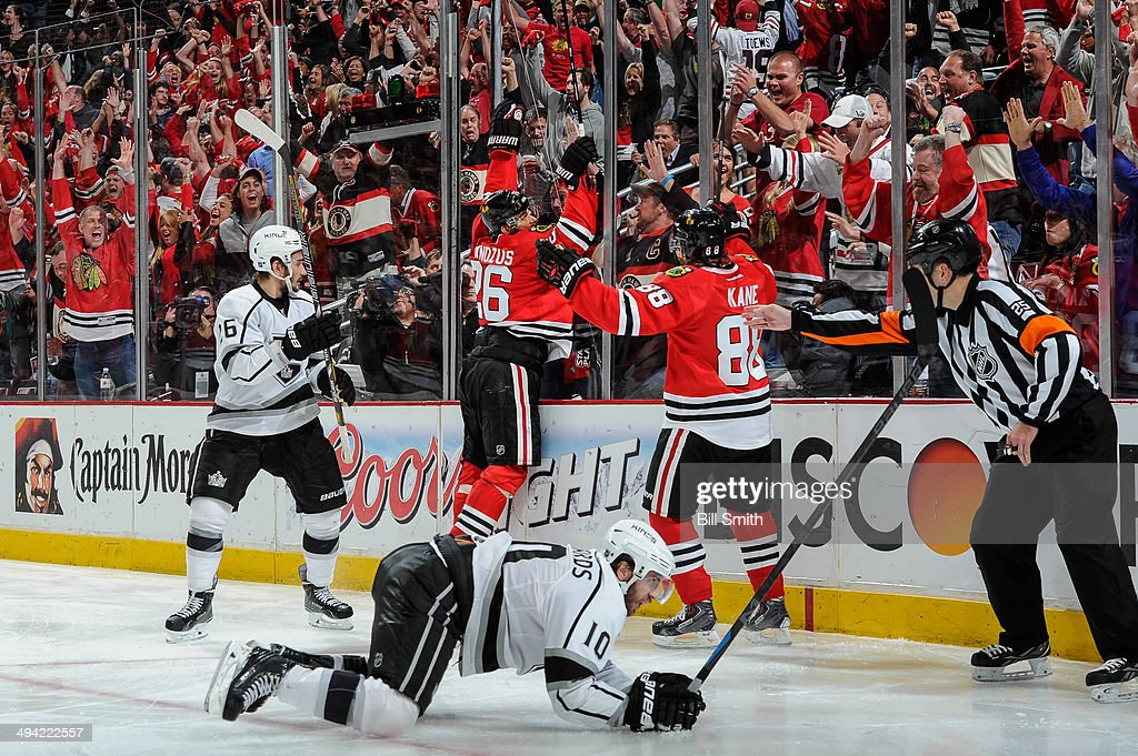 Michal Handzus #26 of the Chicago Blackhawks jumps on the glass after scoring the game winning goal in overtime against the Los Angeles Kings, as Mike Richards #10 of the Kings lays in the foreground, in Game Five of the Western Conference Final during the 2014 NHL Stanley Cup Playoffs at the United Center on May 28, 2014 in Chicago, Illinois.