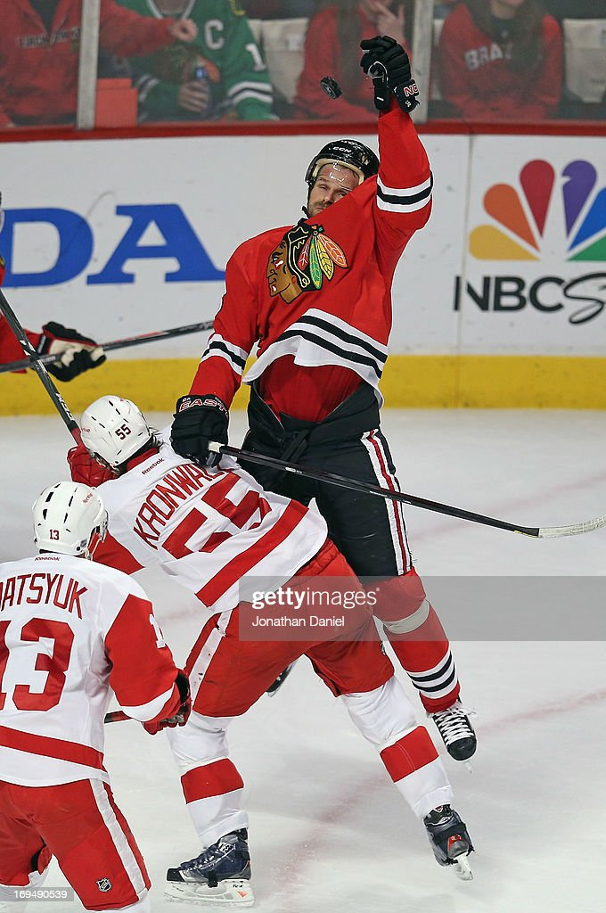 Michal Handzus #26 of the Chicago Blackhawks leaps to knocks down the puck over Niklas Kronwall #55 of the Detroit Red Wings in Game Five of the Western Conference Semifinals during the 2013 NHL Stanley Cup Playoffs at the United Center on May 25, 2013 in Chicago, Illinois.