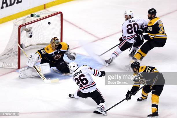 Michal Handzus of the Chicago Blackhawks scores a goal in the first period against Tuukka Rask of the Boston Bruins in Game Four of the 2013 NHL...