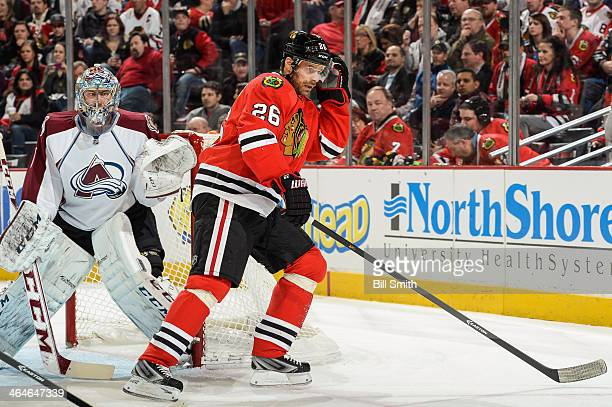 Michal Handzus of the Chicago Blackhawks stands next to goalie Semyon Varlamov of the Colorado Avalanche during the NHL game on January 14 2014 at...