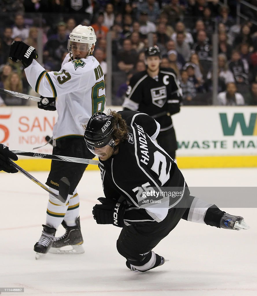 Michal Handzus #26 of the Los Angeles Kings falls to the ice after being hit by Mike Ribeiro #63 of the Dallas Stars in the third period at Staples Center on April 2, 2011 in Los Angeles, California. The Kings defeated the Dallas Stars 3-1.