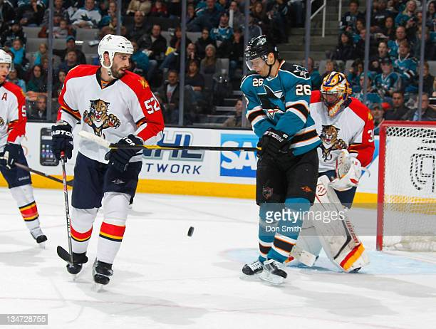 Michal Handzus of the San Jose Sharks tries to screen the goalies vision against Jason Garrison and Scott Clemmensen of the Florida Panthers at HP...