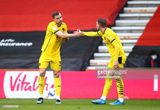 Michal Helik of Barnsley FC celebrates with teammate Cauley Woodrow after scoring his team's first goal during the Sky Bet Championship match between...