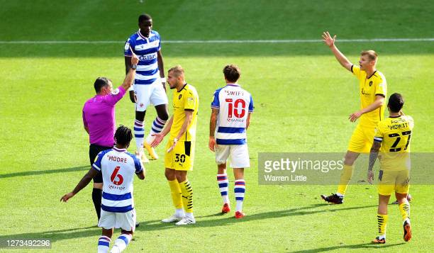 Michal Helik of Barnsley is shown a red card by referee Tim Robinson during the Sky Bet Championship match between Reading and Barnsley at Madejski...