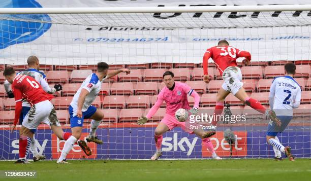 Michal Helik of Barnsley scores their side's first goal past Scott Davies of Tranmere Rovers during the FA Cup Third Round match between Barnsley and...