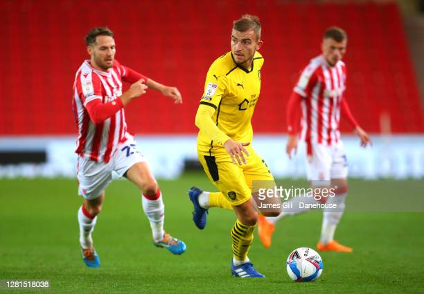Michal Helik of Barnsley turns from Nick Powell of Stoke City during the Sky Bet Championship match between Stoke City and Barnsley at Bet365 Stadium...