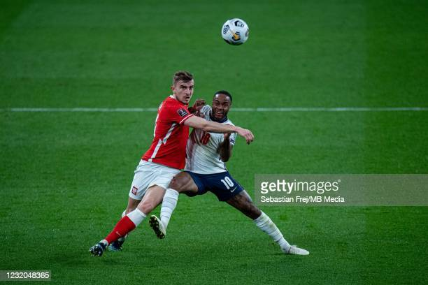 Michal Helik of Poland and Raheem Sterling of England in action during the FIFA World Cup 2022 Qatar qualifying match between England and Poland on...