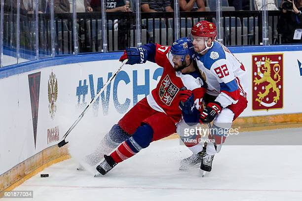 Michal Jordan of Czech Republic and Evgeny Kuznetsov of Russia battle for the puck during the 2016 World Cup of Hockey preparation match between...