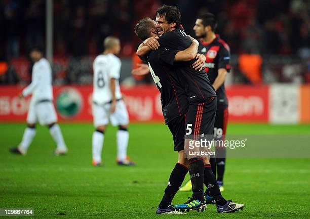 Michal Kadlec of LEverkusen celebrates with team mate Manuel Friedrich after winning the UEFA Champions League group E match between Bayer 04...
