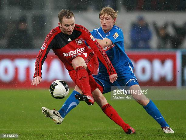 Michal Kadlec of Leverkusen controls the ball as Andreas Beck of Hoffenheim defends during the Bundesliga match between 1899 Hoffenheim and Bayer...