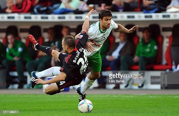 Michal Kadlec of Leverkusen is challenged by Sokratis of Bremen during the Bundesliga match between Bayer 04 Leverkusen and SV Werder Bremen at...
