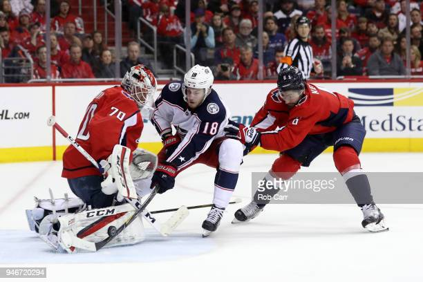 Michal Kempny follows in as goalie Braden Holtby of the Washington Capitals makes a save on a shot by PierreLuc Dubois of the Columbus Blue Jackets...