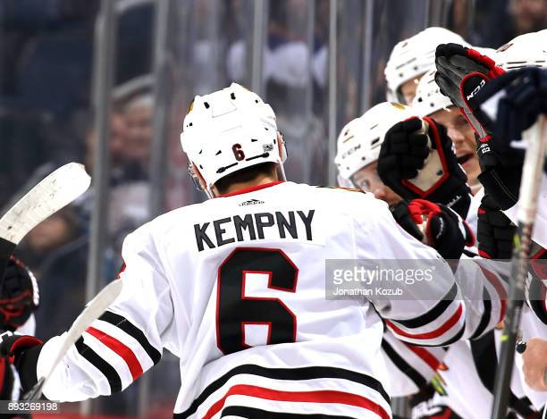 Michal Kempny of the Chicago Blackhawks celebrates his third period goal against the Winnipeg Jets with teammates at the bench at the Bell MTS Place...