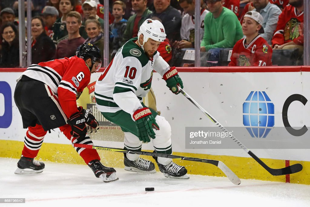 Michal Kempny #6 of the Chicago Blackhawks looses his stick while defending against Chris Stewart #10 of the Minnesota Wild at the United Center on October 12, 2017 in Chicago, Illinois. The Wild defeated the Blackhawks 5-2.