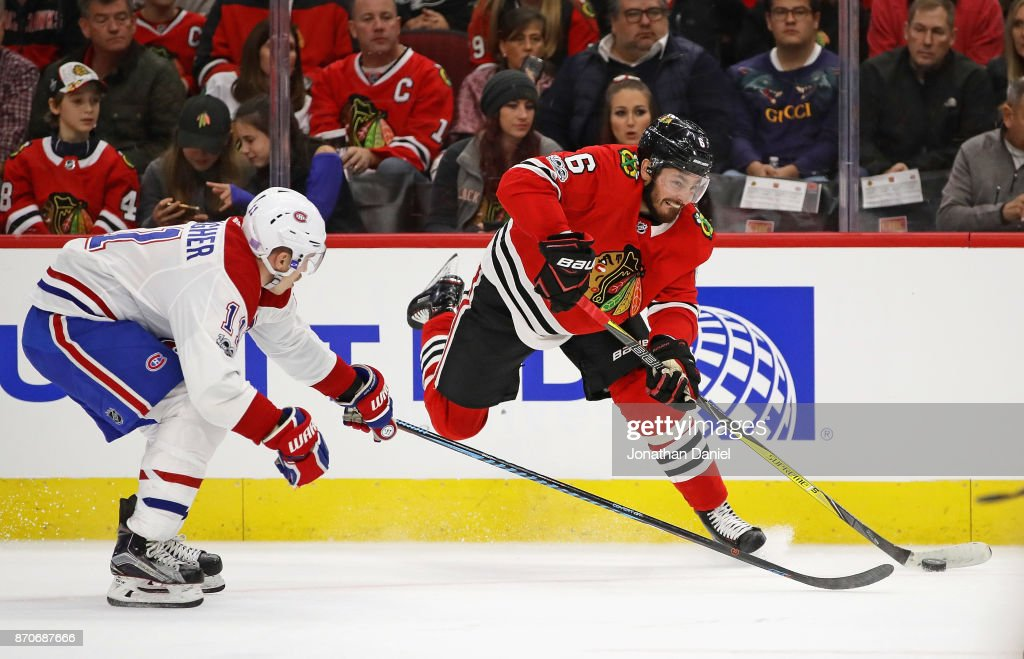 Michal Kempny #6 of the Chicago Blackhawks shoots under pressure from Brendan Gallagher #11 of the Montreal Canadiens at the United Center on November 5, 2017 in Chicago, Illinois.