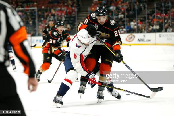 Michal Kempny of the Washington Capitals and Devin Shore of the Anaheim Ducks fight for control of the puck during the third period at Honda Center...