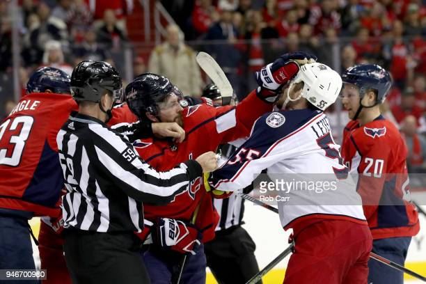 Michal Kempny of the Washington Capitals and Mark Letestu of the Columbus Blue Jackets are seperated in the first period during Game Two of the...