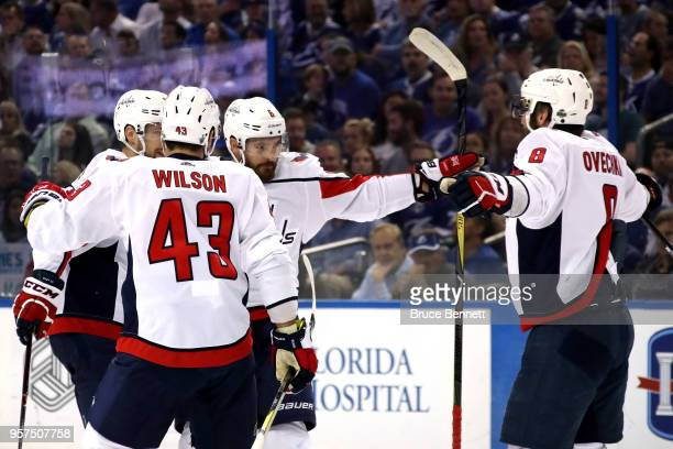 Michal Kempny of the Washington Capitals celebrates with his teammates after scoring a goal against Andrei Vasilevskiy of the Tampa Bay Lightning...
