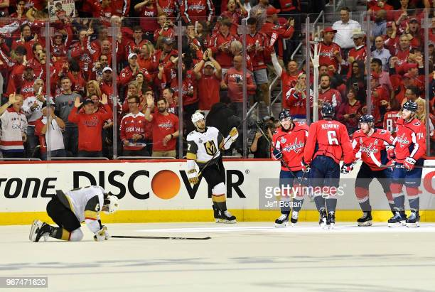 Michal Kempny of the Washington Capitals celebrates with teammates after scoring a goal during the third period against the Vegas Golden Knights in...