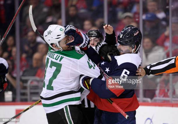 Michal Kempny of the Washington Capitals scuffles with Alexander Radulov of the Dallas Stars during the second period at Capital One Arena on March...