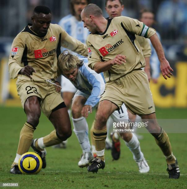 Michal Kolomaznik of Munich challenges JeanClotaire TsoumouMadza and Marko Tredup of Ahlen during the Second Bundesliga match between 1860 Munich and...