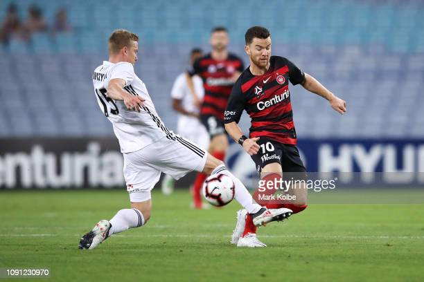 Michal Kopzcynski of the Phoenix tackles Alex Baumjohann of the Wanderers as he passes during the round 12 ALeague match between the Western Sydney...